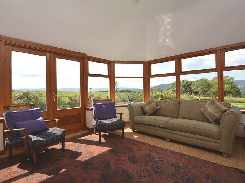 Enjoy the wonderful views over the Cairngorms from the sun room.