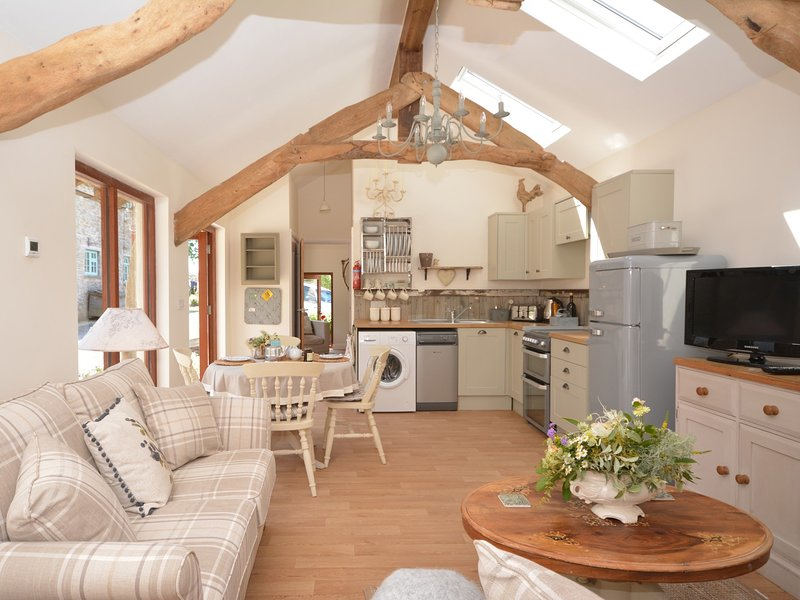 Open-plan lounge/kitchen/diner which has been lovingly decorated