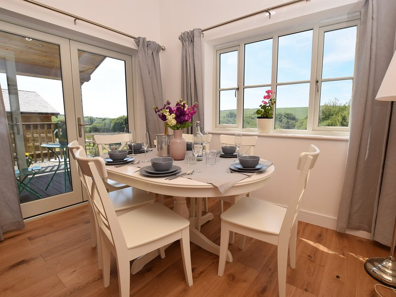 Dining area with French doors leading outside