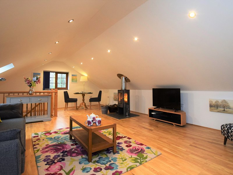 Beautifully finished lounge/dining area with cosy woodburner
