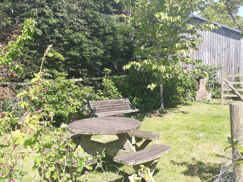 Private seating area near the orchard