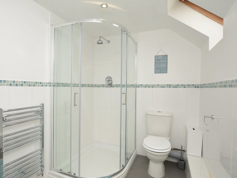 Bathroom with separate shower and corner bath
