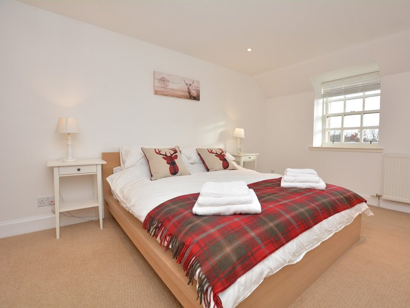 Beautiful king-size bedroom with wonderful views over the garden