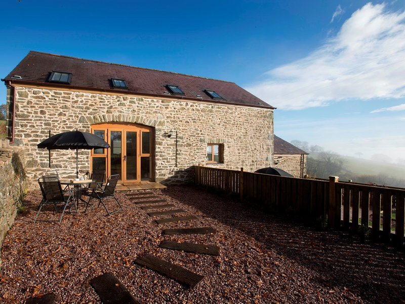 Beautiful converted barn with enclosed grounds and lovely views