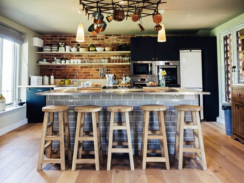 Central kitchen island with stools for perching