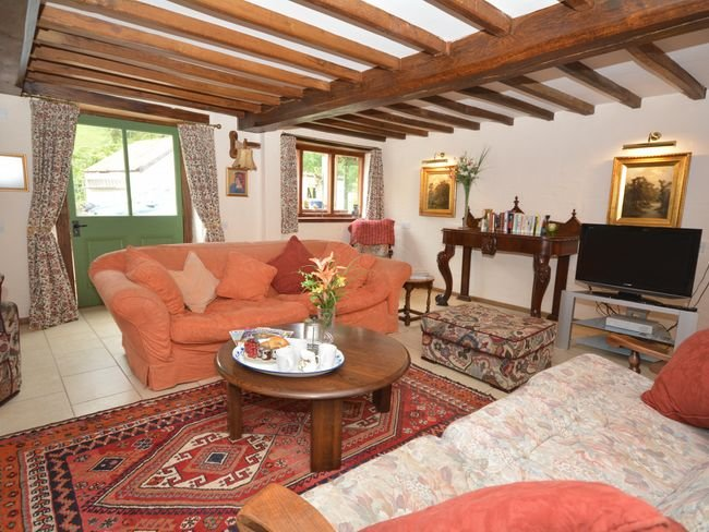 Spacious lounge with feature beams