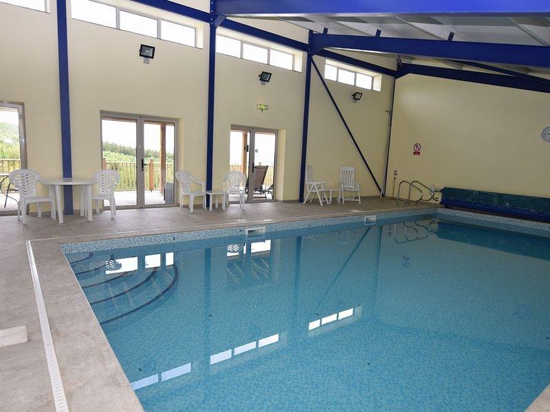 Compartilhado piscina coberta