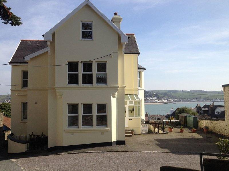 View of the property with sea views