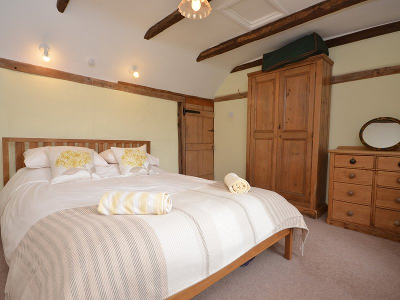 King size bedroom with adjoining twin