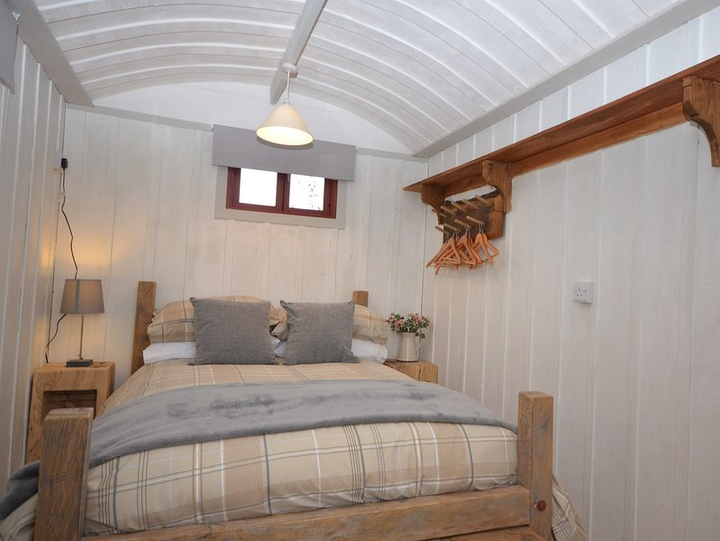 Cosy double bedroom with a woodburner