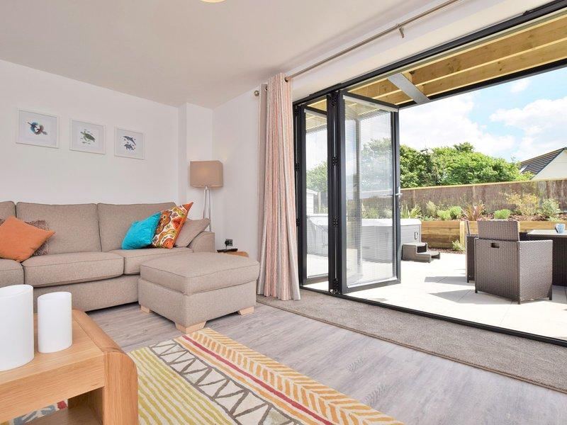 Spacious living area with bi-folding doors to the garden