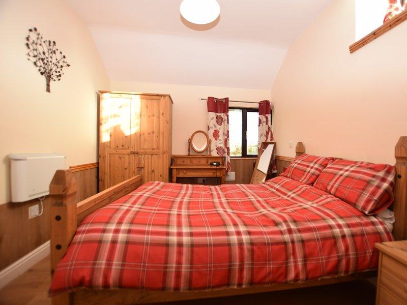 Comfortable double bedroom with en-suite shower room