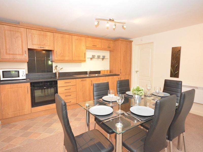 Enter the farmhouse into the open-plan lounge/dining area/kitchen