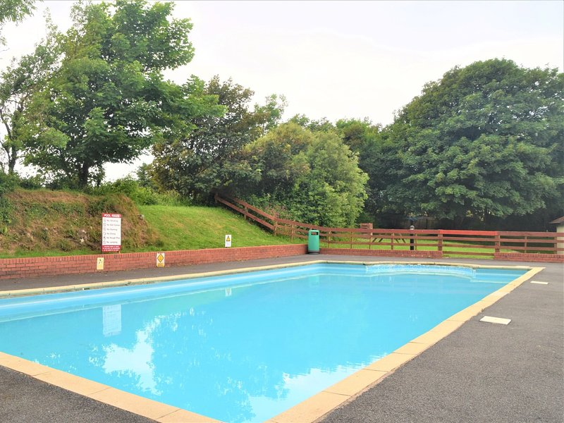 Enjoy a swim in the shared pool located on site