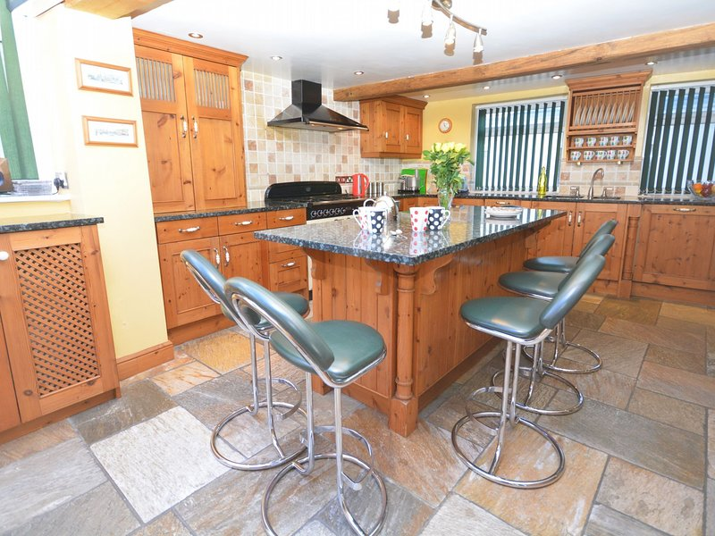 Spacious kitchen with central breakfast bar