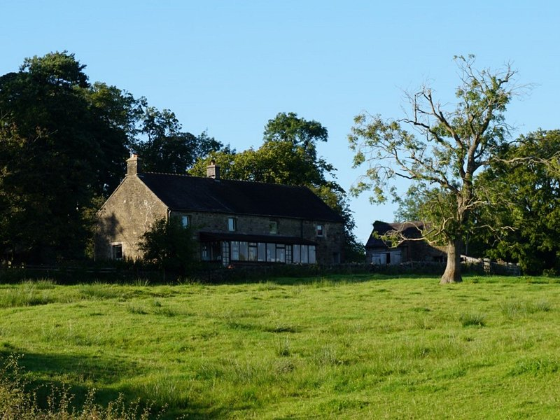 Rolling fields surround the cottage,which can be seen in the distance