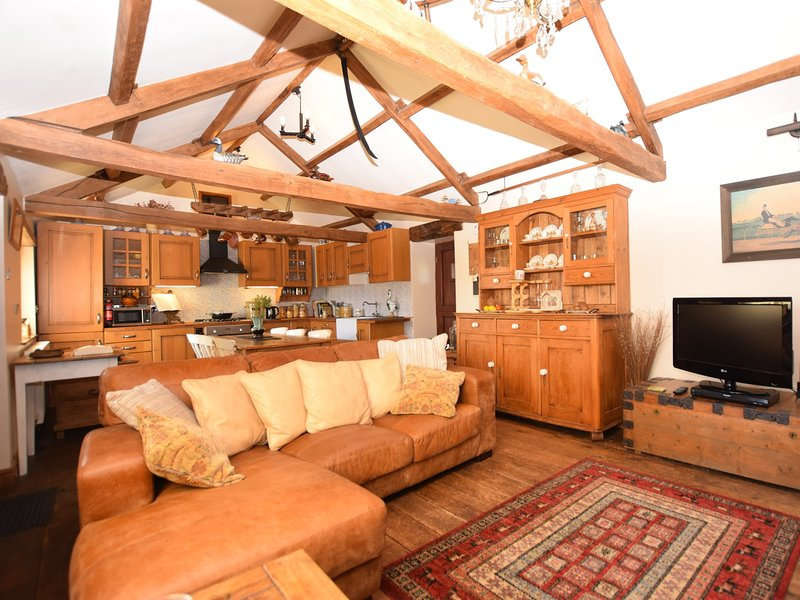 Spacious lounge/kitchen/diner with exposed beams and lots of character