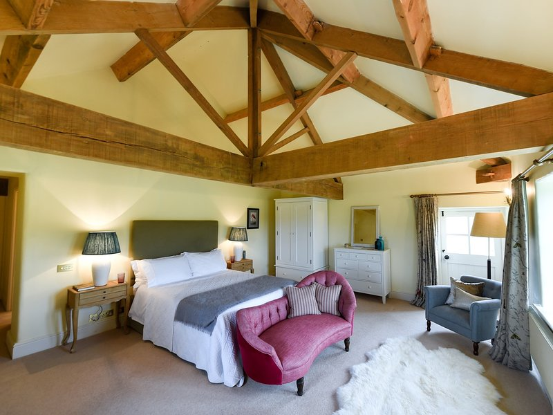 King-size bedroom with exposed beams