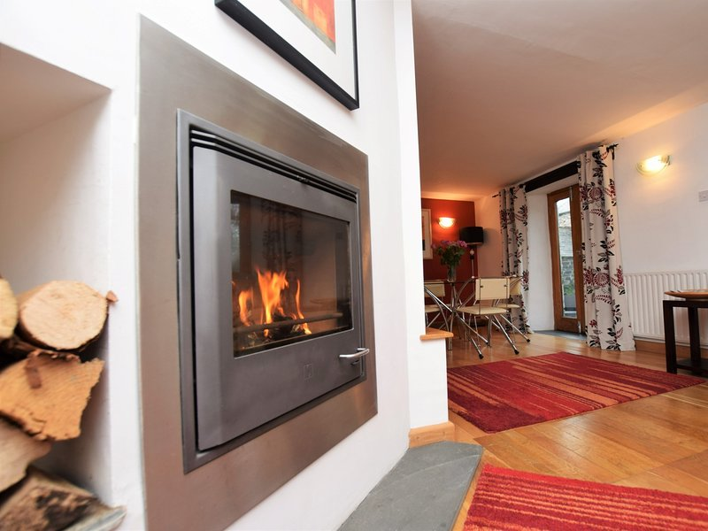 Cosy lounge area with woodburner