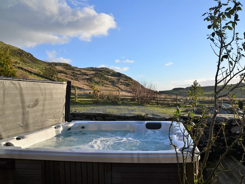 Relax in the hot tub,set in peaceful and private surroundings