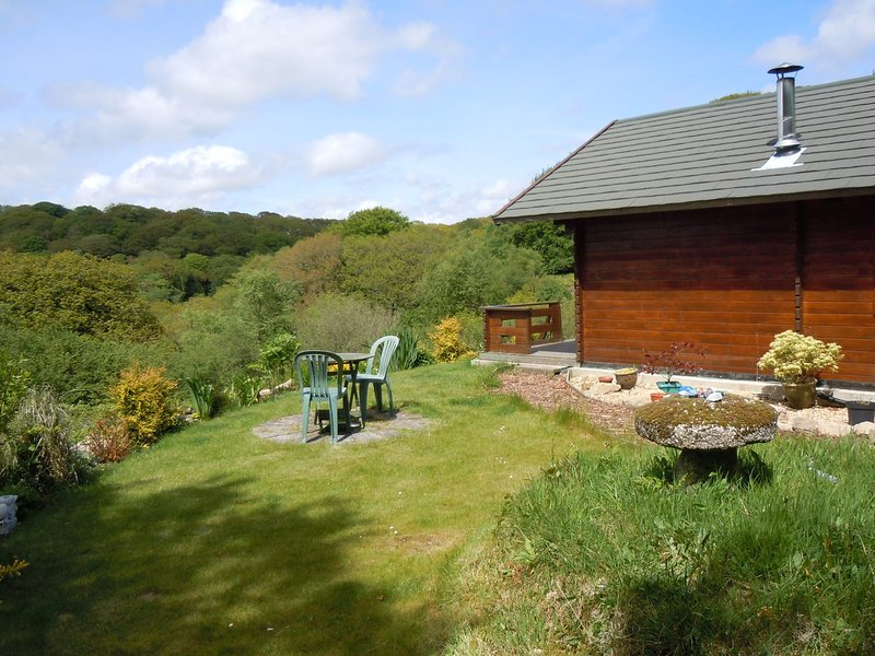 Cabin with view towards the surrounding woodland