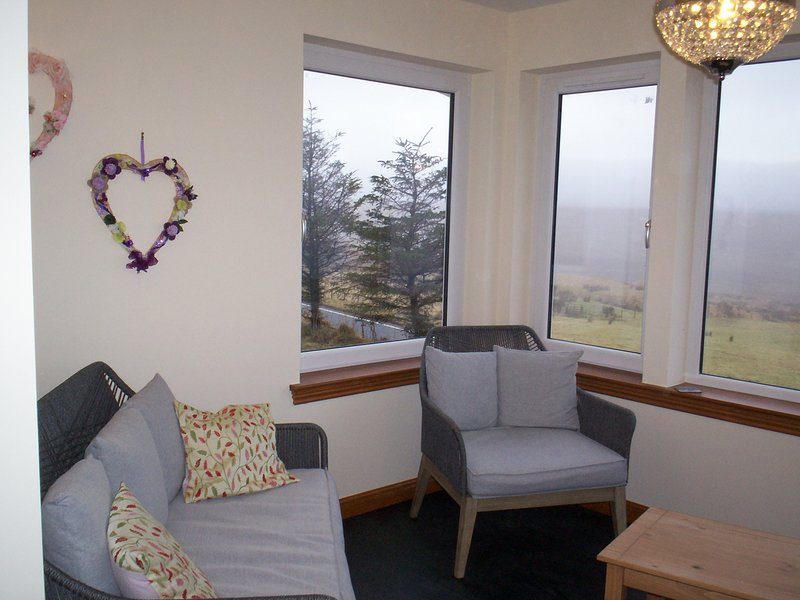 Comfortable seating in the sun room overlooking the Loch and stunning views of the flow country