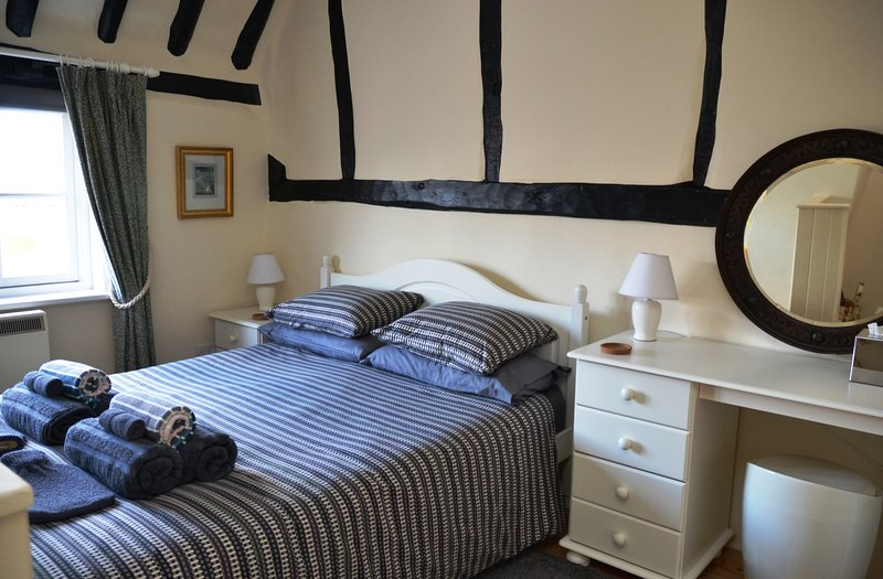 bedding and towels provided, plus hairdryer and st.raighteners in the dressing table drawer