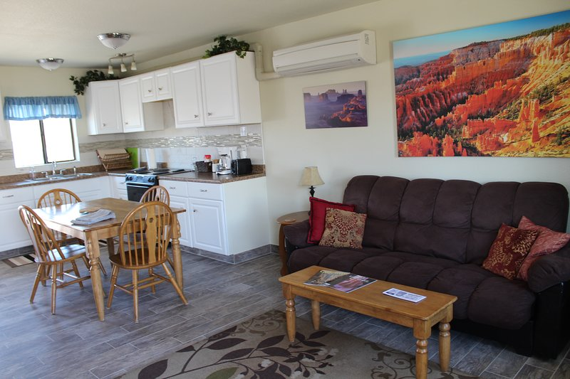 Full kitchen with adjacent foldout couch in living area. 2 private bedrooms. 1 full bath. sleeps 6.