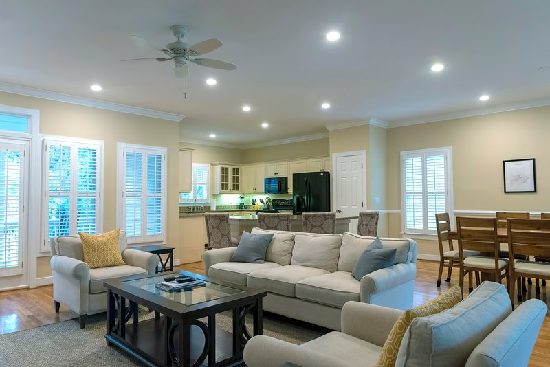 This home features an open floor plan, hardwood floors and new furnishings.