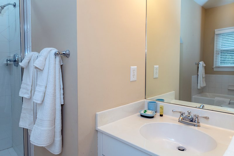 The hall bath is close by and has a granite-topped vanity.