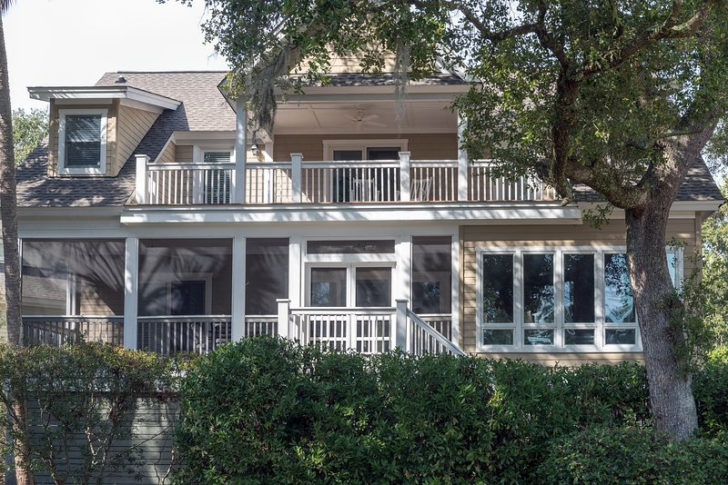 The back of the house has multiple decks and porches to sit and capture the beautiful scenery.