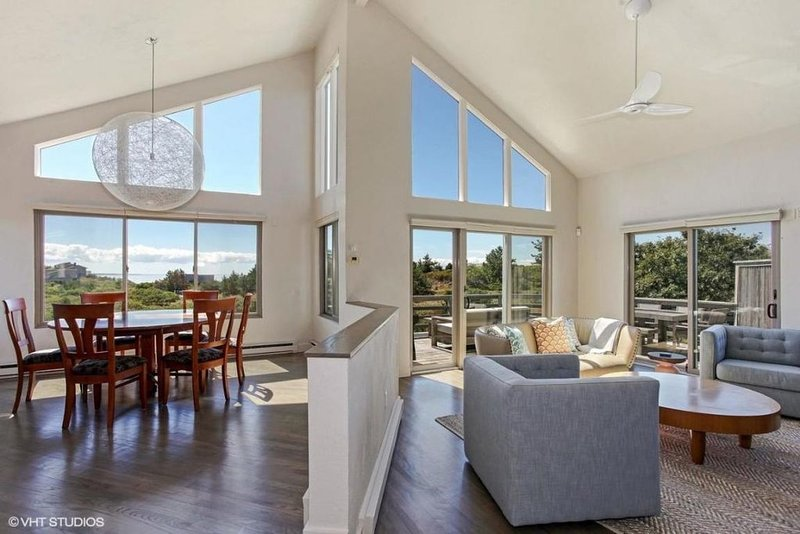 Dining and living room and bay views - Looking forward to sunset!