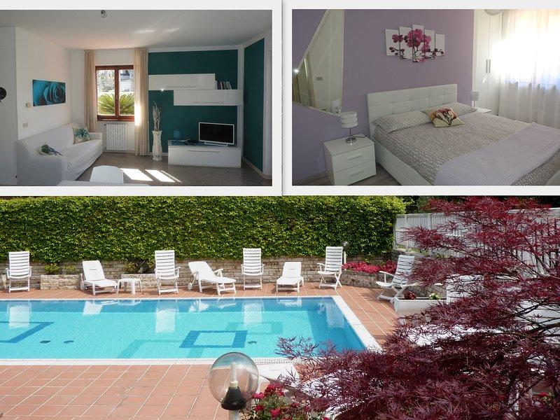 VILLA FIORI - Appartamento con piscina, giadino e vista lago, holiday rental in Polsa