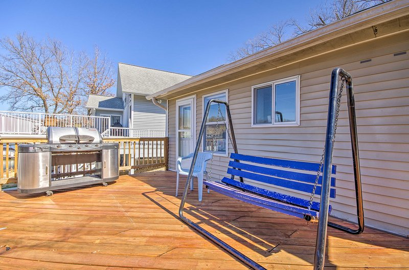 This lakefront home includes a double deck and 4000-lb boat lift.