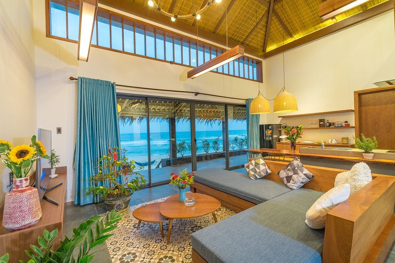 Opened living room and kitchen facing up the beach front