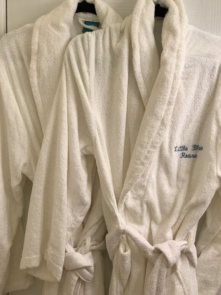 Four adult-size Terry robes for your use.