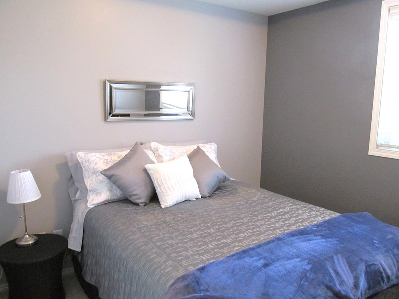Bedroom 2 features new luxurious pillowtop bed, new bedding and furniture; 32' TV, closet/  hangers