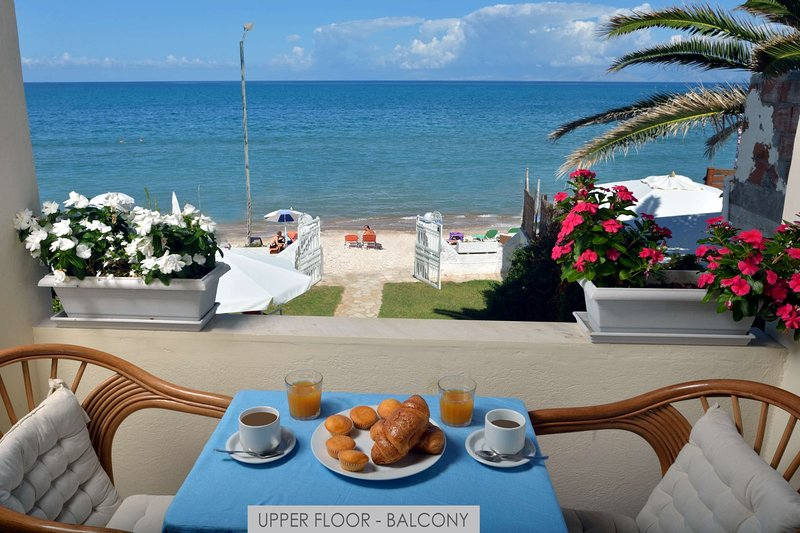 Sea and Sun Apartments - Upper Floor apartment directly on the beach, vacation rental in Corfu