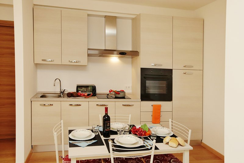 The livingroom with view on the kitchen corner with dinnertable