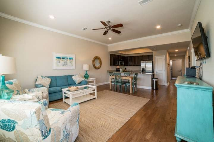 Large and spacious living room and dining room with warm costal colors