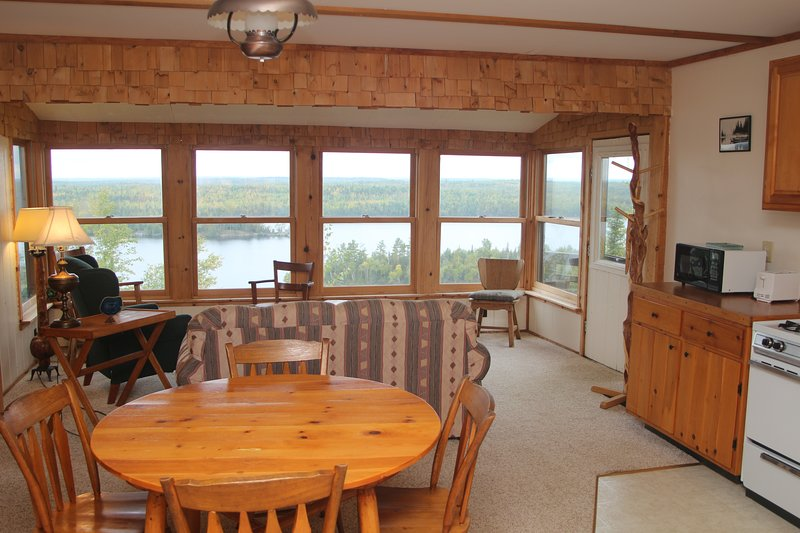 Dining area and living room overlooking Moose Lake