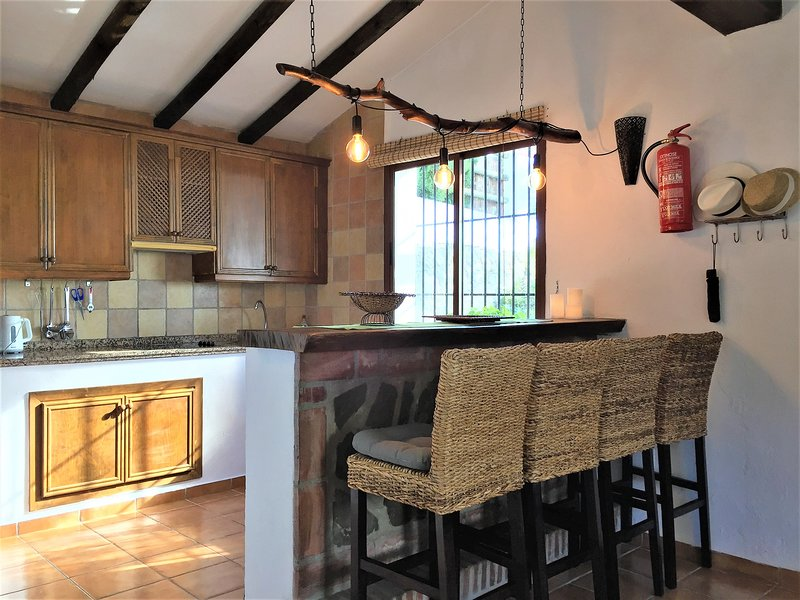 The fully equipped kitchen and breakfast bar