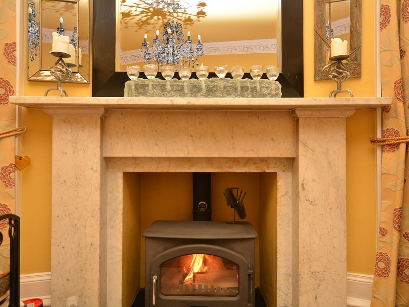 Enjoy cosy nights in by the roaring wood burner in the lounge
