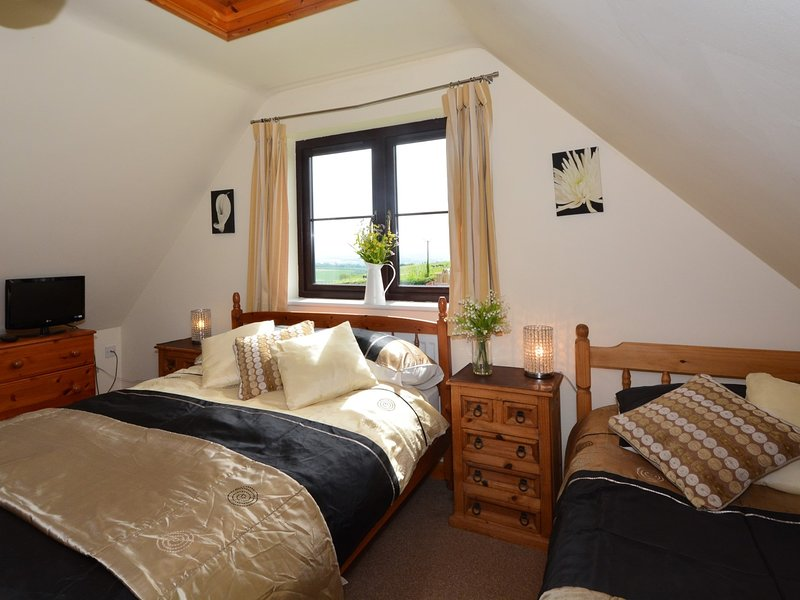 Master bedroom with single bed and en-suite