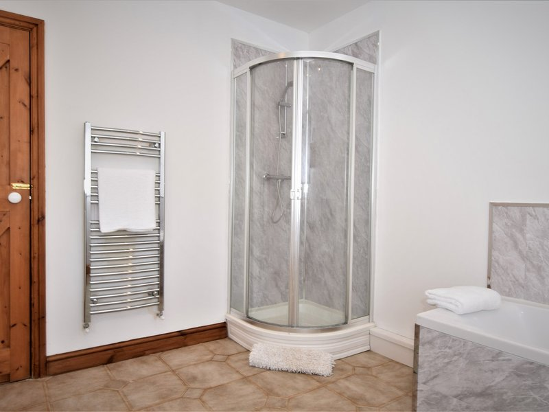 Lovely large bathroom with bath and seperate shower