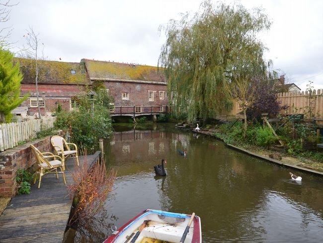 River running alongside the enclosed garden