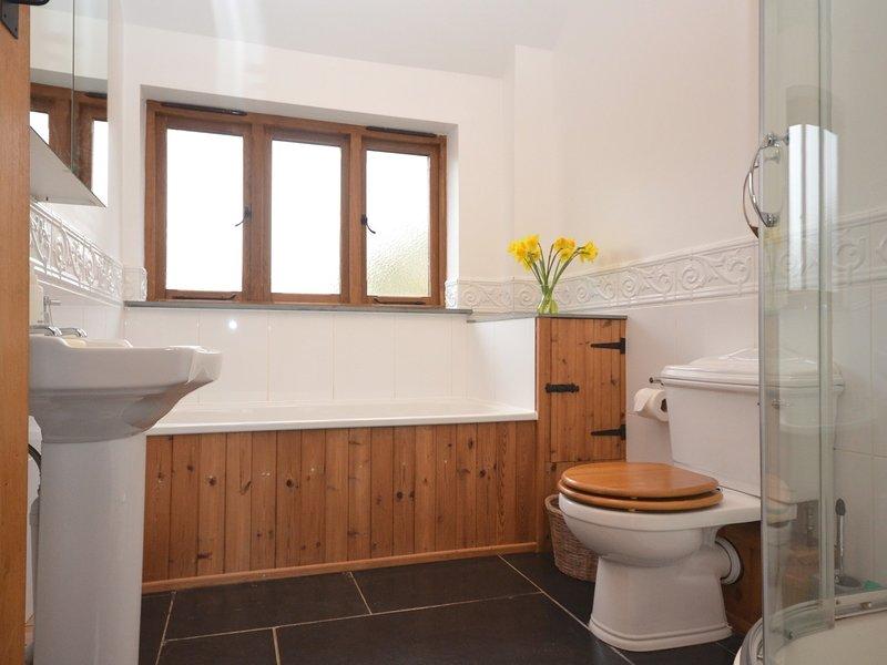 En-suite bathroom with bath and separate shower