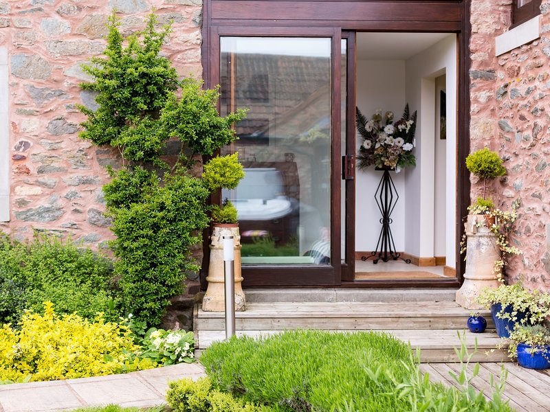 Quaint entrance to the property with beautifully looked after gardens