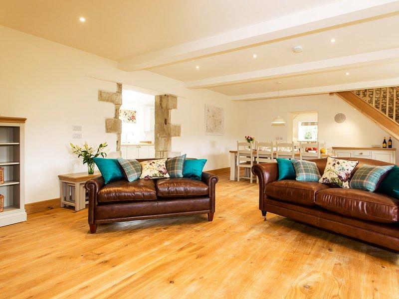 Beautiful open plan lounge/diner with oak flooring