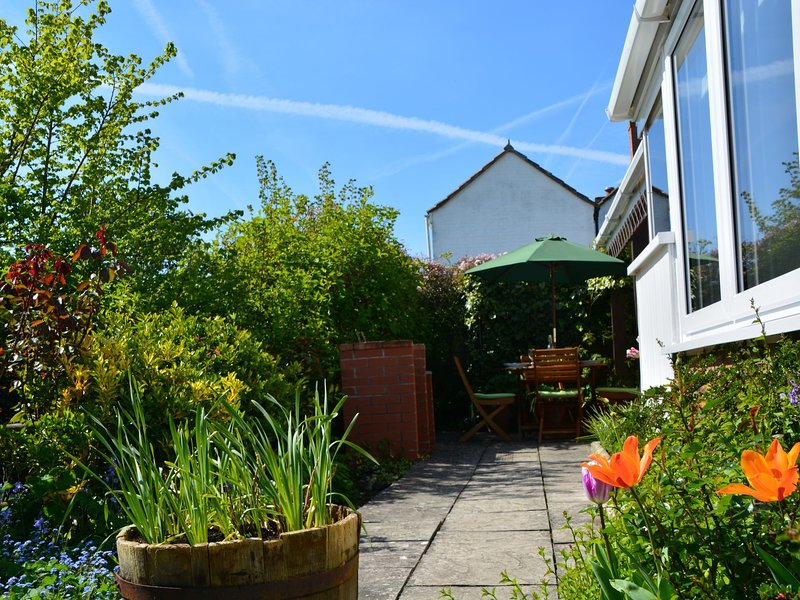 Beautiful garden area surrounding 3 sides of the property